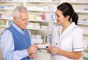 pharmacist talking to a customer